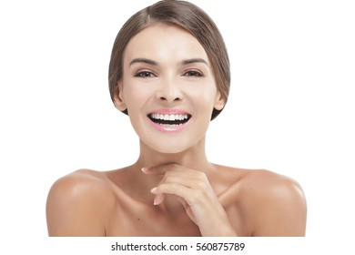 portrait of beautiful girl with natural make up laughing isolated on white background