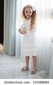Portrait of beautiful girl near white curtain