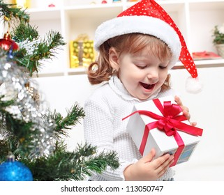 portrait of a beautiful girl on a background of the Christmas tree