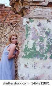 Portrait of a beautiful girl on the background of a dilapidated mansion. Mysterious and fabulous image