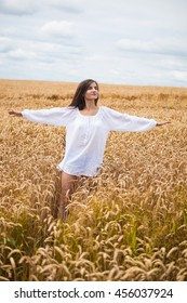 portrait of a beautiful girl on a background field