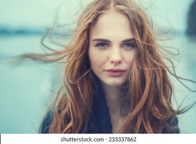 portrait of a beautiful girl on a cold windy day