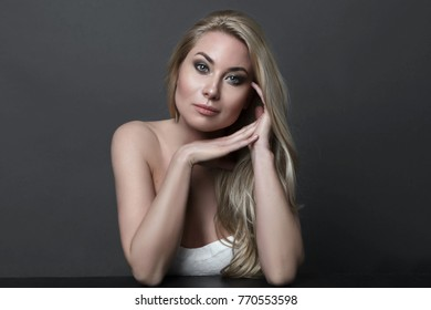 portrait of a beautiful girl on dark background Glamour fashion portrait