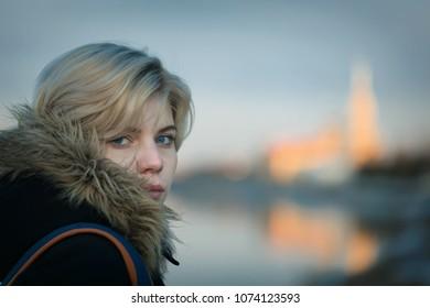Portrait of a beautiful girl on an evening evening stroll