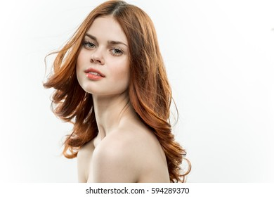 portrait of a beautiful girl on a light background