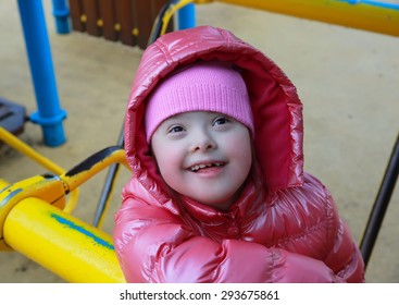 Portrait of beautiful girl on the playground