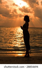 Portrait of a beautiful girl on the sunrise background