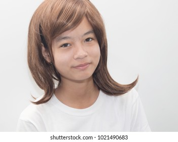 Portrait of a beautiful girl on a white background