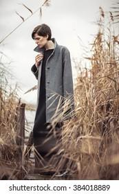Portrait of beautiful girl outdoors in autumn