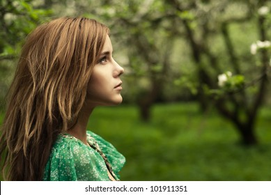 portrait of a beautiful girl in the park
