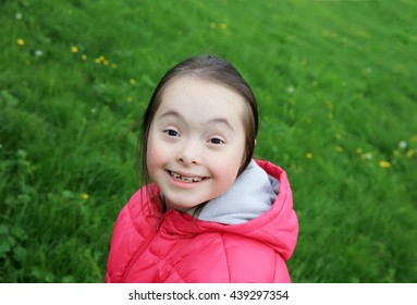 Portrait of beautiful girl in the park