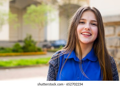 Portrait of a beautiful girl in park.