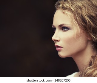 Portrait of a beautiful girl with perfect skin in a profile