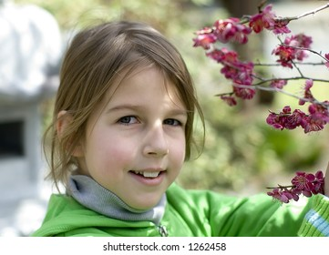 Portrait of beautiful girl with plum blossom