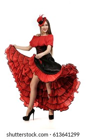 Portrait of a beautiful girl in a red cancan dress on a white background studio