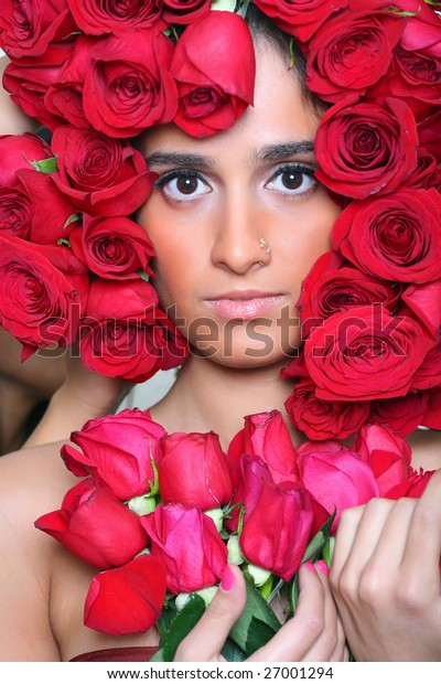 Portrait of the beautiful girl rolling in roses, please look other photos of this series:
