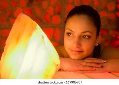 Portrait of the beautiful girl in salt room.