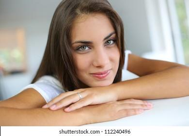 Portrait of beautiful girl sitting in sofa
