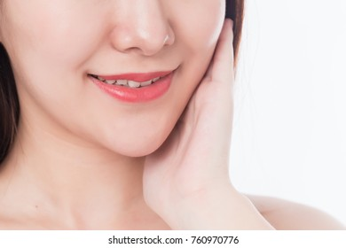 Portrait of beautiful girl smiling looking at camera.