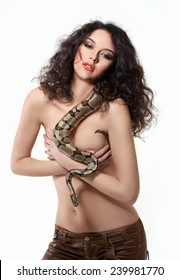 portrait of a beautiful girl with a snake on the shoulder