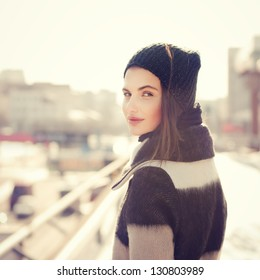 portrait of a beautiful girl with a Spanish appearance in winter
