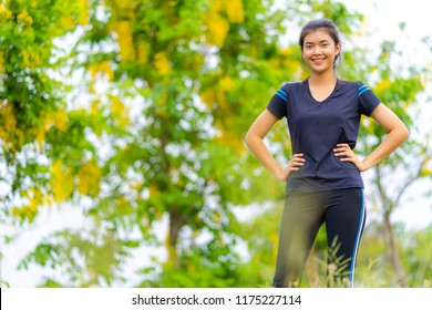 Portrait of beautiful girl in sportswear, running healthy fitness woman training for marathon outdoors