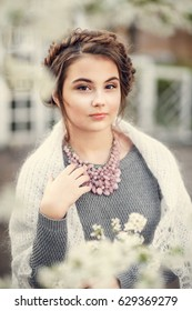 Portrait of a beautiful girl in spring park. Vintage.