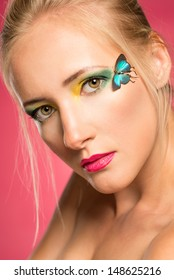 Portrait of a beautiful girl with strong make-up and butterfly