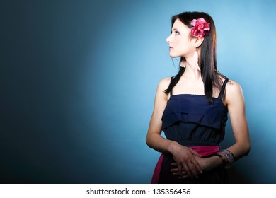 Portrait of beautiful girl in summer style on blue background. Travel and Vacation concept