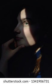 Portrait Of A Beautiful Girl With Sun Rays On Face