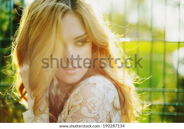 portrait of a beautiful girl in sunlight outdoor