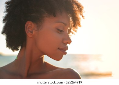 Portrait of a beautiful girl in the sunset time