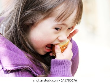 Portrait of beautiful girl that eating baguette