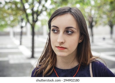Portrait of a beautiful girl thinking