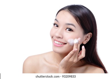 Portrait of beautiful girl touching her pretty face with cleansing foam - white background, model is a asian beauty