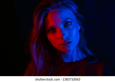 Portrait of a beautiful girl in two colors, red and blue.