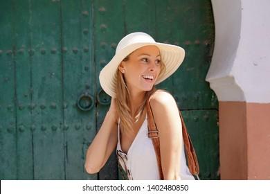 Portrait of beautiful girl visiting Marrakech, wearing sun hat
