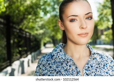 portrait of a beautiful girl walking down the street