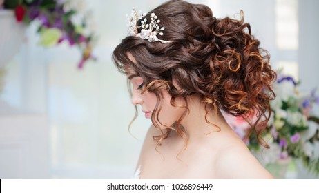 Portrait of a beautiful girl in a wedding dress. Bride in luxurious dress, close-up