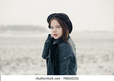 portrait of a beautiful girl in a winter hat in the cold