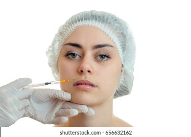 Portrait of a beautiful girl without makeup which cosmetologist doing facial injections