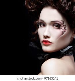 portrait of beautiful halloween woman vampire baroque aristocrat over black background