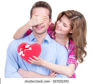 Portrait of beautiful happy couple isolated on white background. Attractive women make a surprise to man.