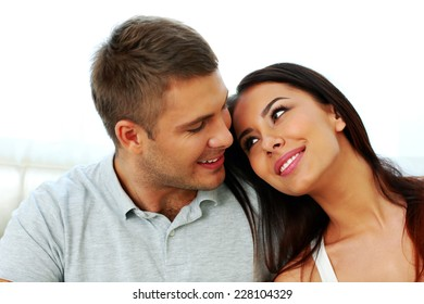 Portrait of a beautiful happy couple looking at each other