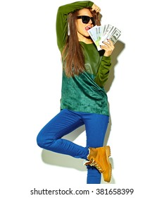 portrait of beautiful happy cute smiling brunette woman girl in casual green hipster summer clothes with no makeup isolated on white holding dollar and euro banknotes