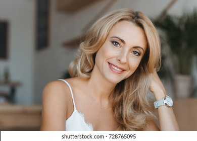 portrait of beautiful happy middle aged woman smiling at camera