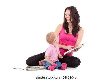 Portrait of a beautiful happy mother with child 2 years boy read book isolated on white