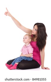 Portrait of a beautiful happy mother point finger to the up corner with child 2 years boy isolated on white