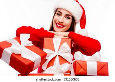 Portrait of beautiful happy santa girl with xmas presents