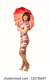 Portrait of a beautiful happy smiling girl with red umbrella isolated on white